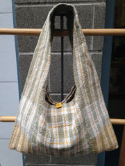 woven bag hanging in front of shop