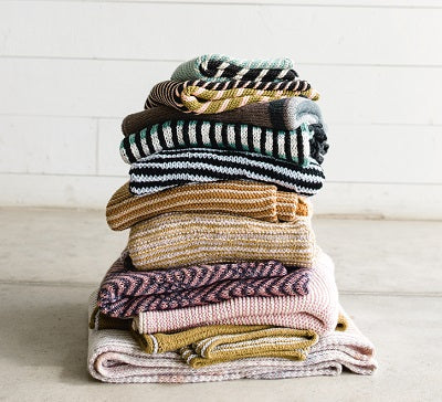 stack of striped summer sweaters