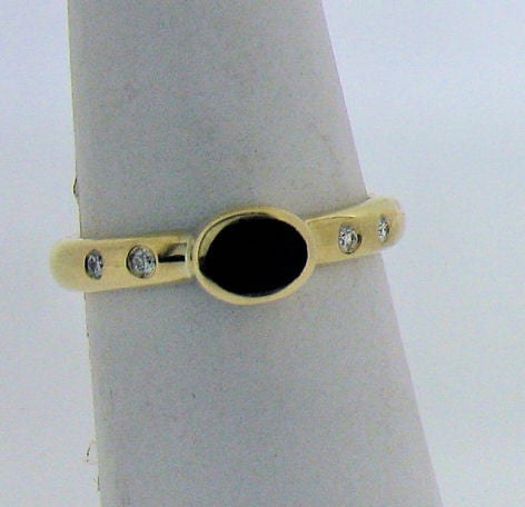 Whitby Jet and Diamond Gold Ring NR19