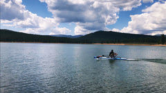 Sculling on Prosser Lake, California.  SUP with sliding rigger, Xeno Muller