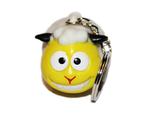 Smiling Pooping Sheep Keychain