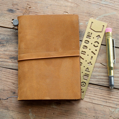 camel travelers notebook with brass accessories