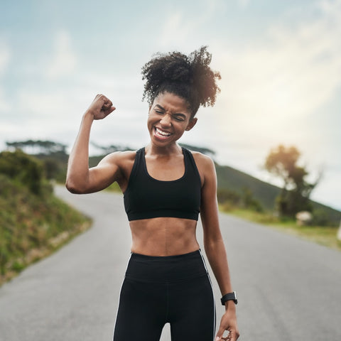 woman flexing her arm on a road