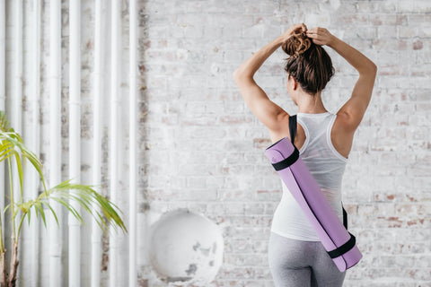 yoga mat in a carrying strap