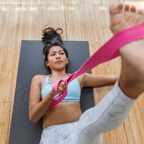 stretching using a yoga strap