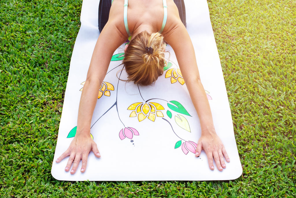 Child's pose on a white personalised DIYogi yoga mat