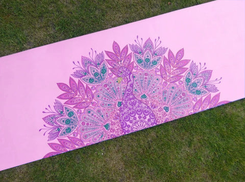 peacock drawing on purple yoga mat