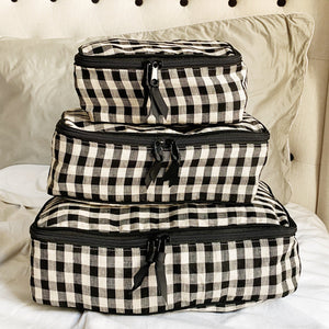 Linen checkered packing cubes in sized small medium and large.