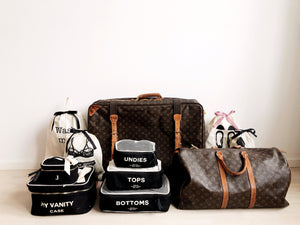 Louis vuitton duffles with vanity cases, laundry bags and packing cubes.