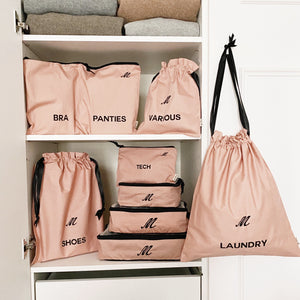 a closet with pink bag-all organizing products.