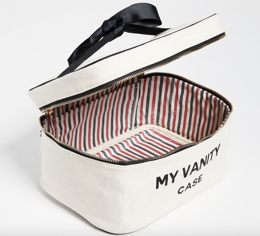 "White beauty box with ""my vanity case"" on the front with black details and black bow."