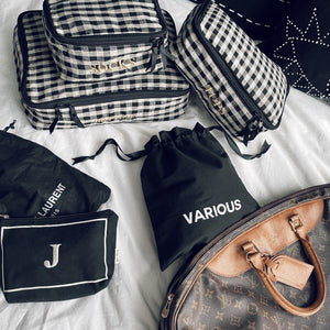 Louis Vuitton duffle with checkerd packing cubes, various bag and a small multiuse case.