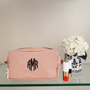 Pink Souki toiletry case with initials monogrammed on the front.