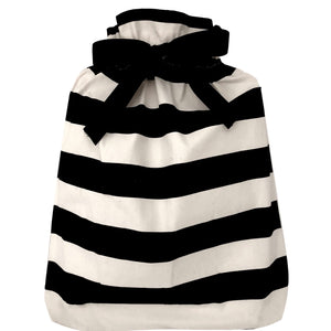 A large gift bag with black and white stripes horizontally across.