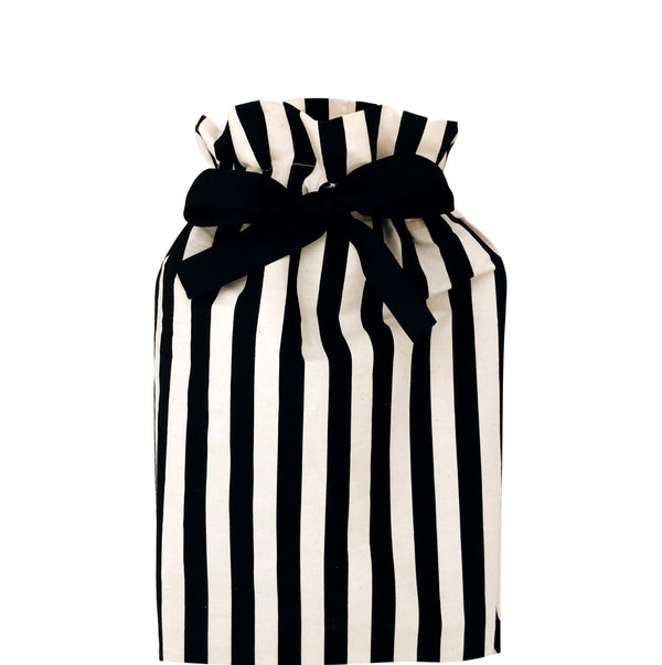 Medium gift bag black and white vertically striped.