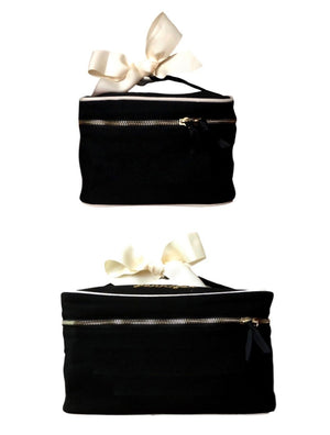 Small black blank organizing box with white details and a white bow attached to the handle.