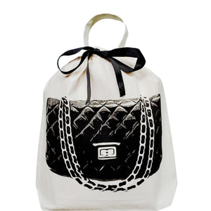 Travel organizing bag with a quilted handbag replicating a chanel purse on the front.