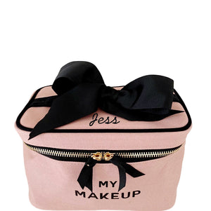 "My makeup case in pink with ""jess"" monogrammed on the front."
