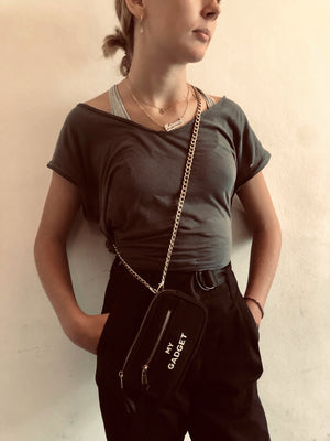 A girl wearing her my gadget phone case around her shoulder.