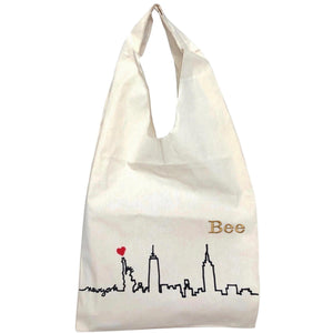 "Tote bag with the manhattan skyline across the bottom and ""Bee"" monogrammed on the fornt."
