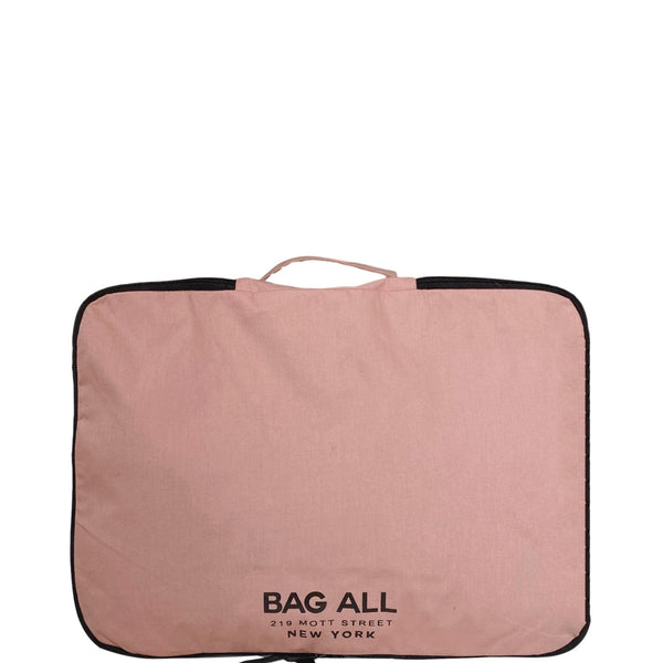 Double sided pink packing cubes for travel and organizing.
