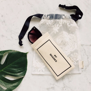 White lace bag with my shades sunglasses case inside.