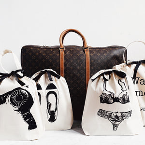 louis vuitton duffle with hairdryer, ballet flats, lace lingerie and laundry travel bags.