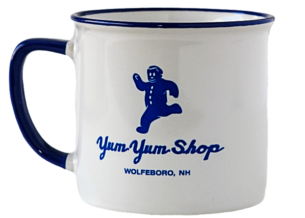 A white metal mug with the Yum Yum Shop logo printed in blue.