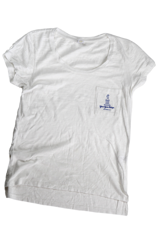 A white women's short sleeve tee with the Yum Yum Shop and name printed on the pocket.