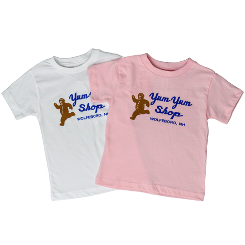 Two toddler short sleeve tees in pink and white with the Yum Yum Shop logo printed in the center.