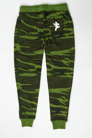 Women's green camo pants with the Yum Yum Shop gingerbread man printed on the back pocket.