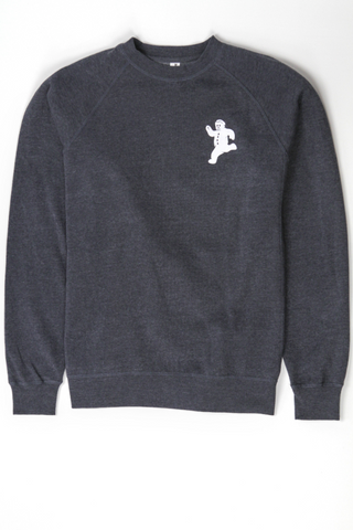 A grey fleece sweatshirt with the Yum Yum Shop running gingerbread man printed in the upper corner.