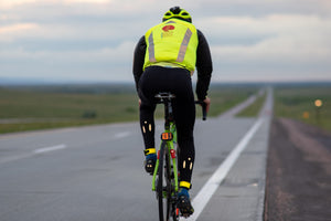 Rear view of cyclist Keith Morical riding across the U.S. as he sets a Guinness World Record for fastest time cycling though every state
