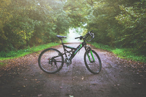 Empty bicycle on a wooded dirt road