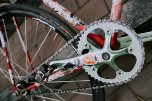 Close up of the front chainrings and chain on a bicycle