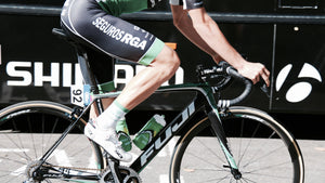 Close-up on a cyclist's legs while pedaling on a ride