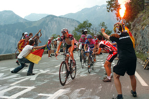 Riders finishing a mountain climb at the Tour de France