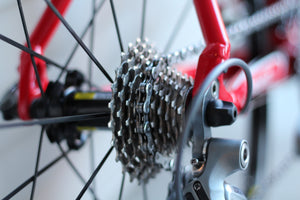 Close-up of a rear-wheel bicycle gear cassette on a red bike
