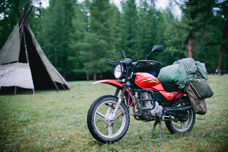 A Ranger's old Chinese motorcycle. These beasts of burden are used daily. The Yamaha AG-200's donated by MEC will be put to good use. In the background, a typical Mongolian dwelling called a Ger—sometimes known as a yurt in Western culture