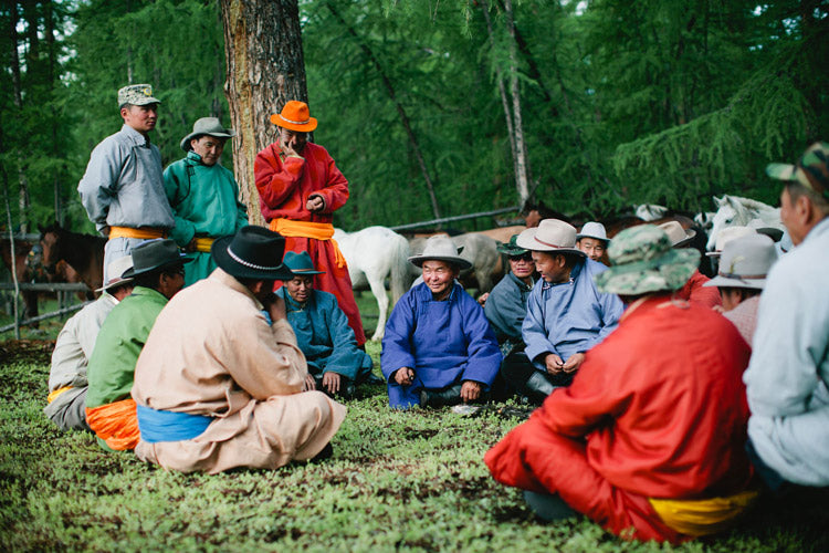 A gathering of the rangers preceeding the dedication ceremony for the Yamahas. Tumersic, center in blue, is the leader of the group. The land patrolled by these men is so vast they might only see each other a few times a year.