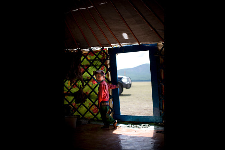 A boy in traditional Mongolian roundhouse where we stayed.