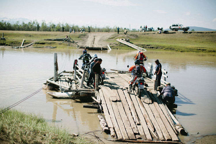 A ramshackle ferry, pulled from shore to shore by hand along a steel cable, was our only way across this particularly deep river crossing.