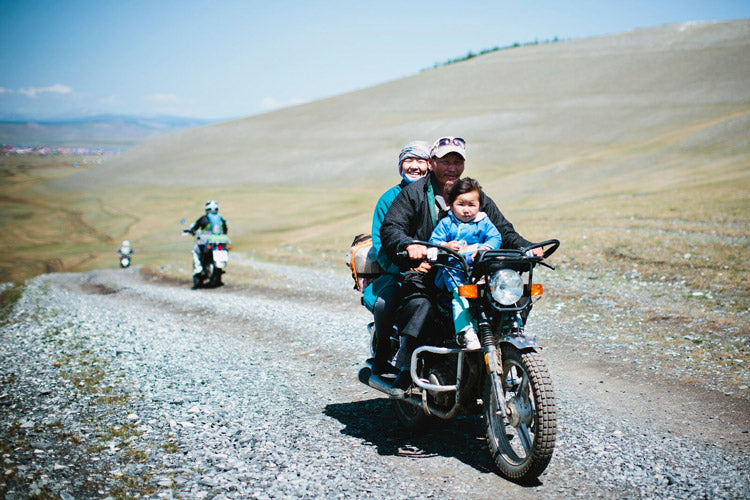 It's not uncommon to see entire families traveling on a single motorcycle in Mongolia. I was constantly amazed by how gratified most people I met were to have their photos taken.