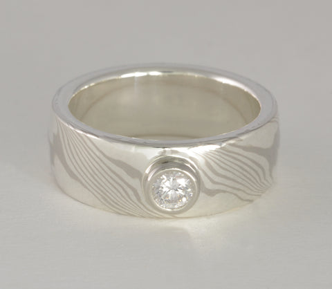 Custom: 14kt Palladium White Gold and Sterling Silver Wide band with Bezel Set Diamond