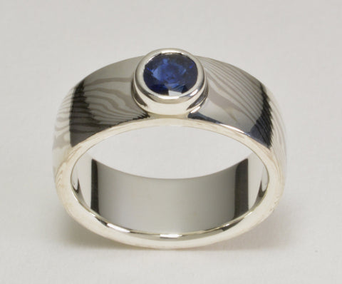 Custom: Palladium White Gold and Sterling Silver Mokume Ring with Bezel Set Blue Sapphire