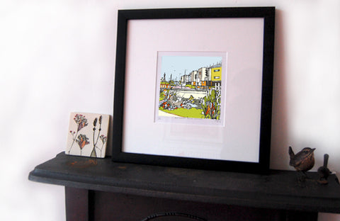 print of Blackpool FC, Bloomfield Road displayed on a mantlepiece