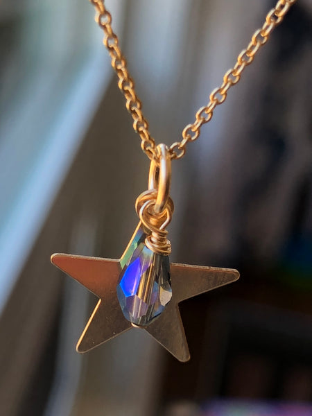 14KT gold filled 5 point star with single purple haze crystal dangling from the pendant.