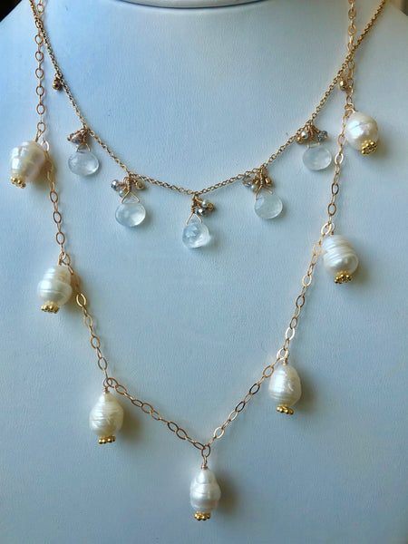 faceted pear shaped moonstone on 14KT gold fill chain.  Paired with fresh water pearl necklace.