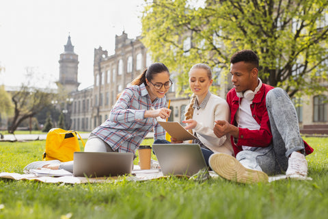 Group-of-college-students-studying-outside