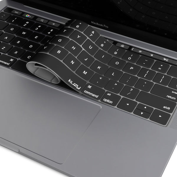 A-black-silicone-keyboard-cover-partially-pulled-back-over-a-MacBook-Pro-keyboard